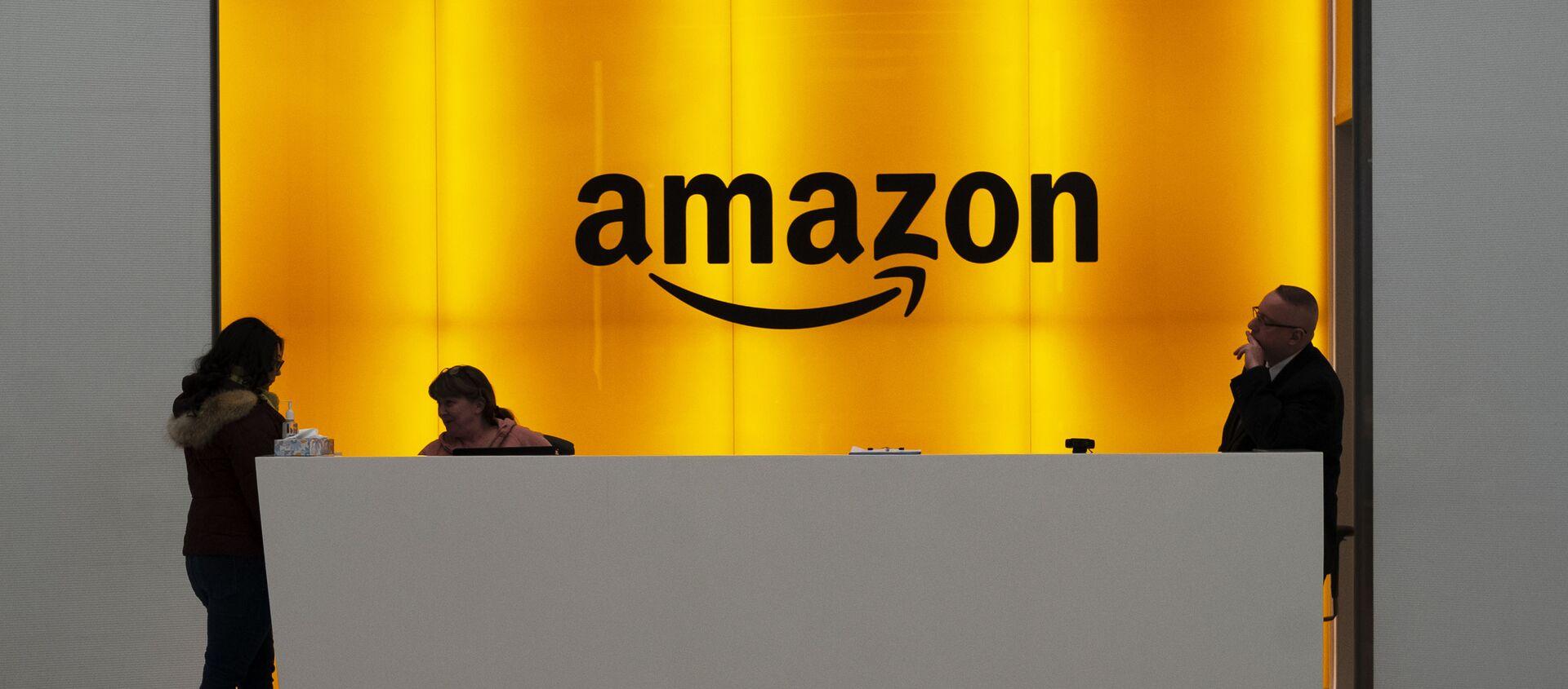 Imagen de archivo. Personas en el vestíbulo de las oficinas de Amazon en Nueva York - Sputnik Mundo, 1920, 22.01.2021