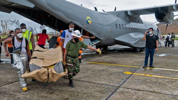 Avión con ayuda humanitaria para la isla colombiana de Providencia - Sputnik Mundo
