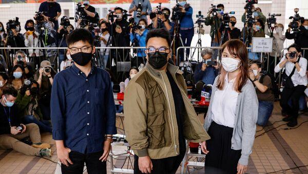 Los activistas hongkoneses Ivan Lam, Joshua Wong, Agnes Chow - Sputnik Mundo