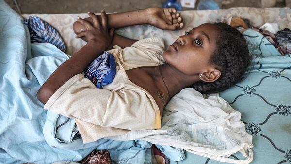 Девушка, пострадавшая в ходе боевых действий в Хумере, Эфиопия - Sputnik Mundo
