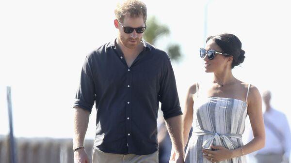 El príncipe Harry y su esposa, Meghan Markle, el 22 de octubre de 2018 - Sputnik Mundo