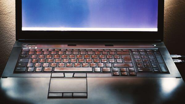 Una computadora portátil (imagen referencial) - Sputnik Mundo