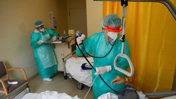 Médicos alemanes durante el brote de coronavirus - Sputnik Mundo
