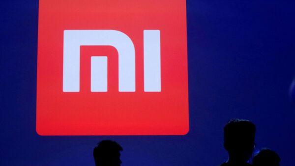 Logo de Xiaomi (imagen referencial) - Sputnik Mundo