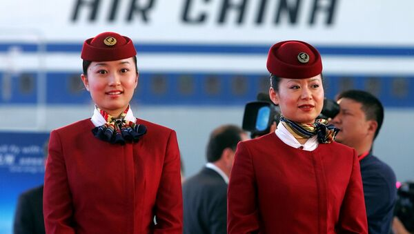 Unas azafatas de la aerolínea china Air China - Sputnik Mundo
