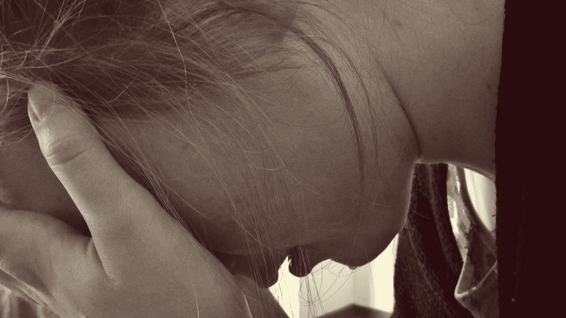 Una mujer llorando - Sputnik Mundo, 1920, 05.03.2021