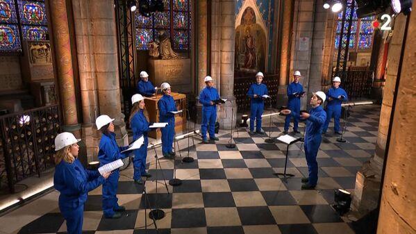 El coro de Maitrise Notre-Dame de París durante un concierto de Navidad en la catedral de Notre Dame de París. - Sputnik Mundo
