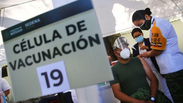 México comienza la vacunación contra COVID-19 - Sputnik Mundo