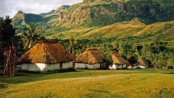 Unas cabañas en una de las islas Fiyi - Sputnik Mundo