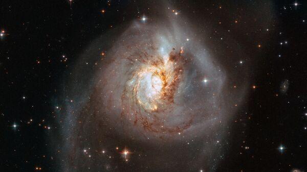 La galaxia NGC 3256 - Sputnik Mundo