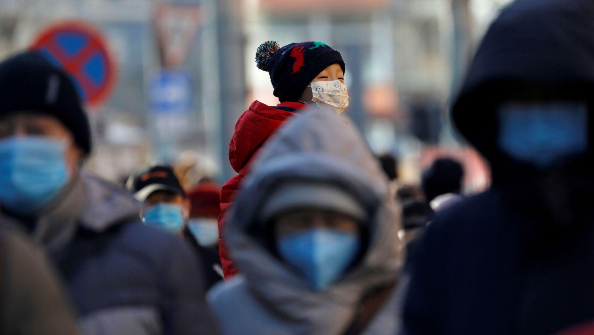 Unas personas con mascarillas en China, referencial - Sputnik Mundo, 1920, 11.01.2021