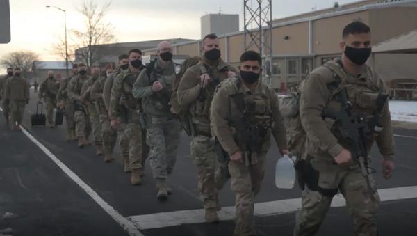 Los Guardia Nacional se dirige a Washington para la juramentación de Biden  - Sputnik Mundo
