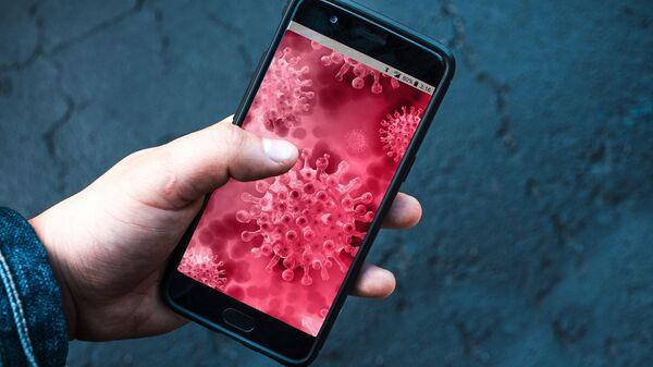 Un teléfono con una imagen del coronavirus (referencial) - Sputnik Mundo