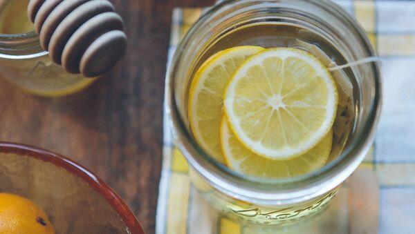 Un té con unas rodajas de limón - Sputnik Mundo