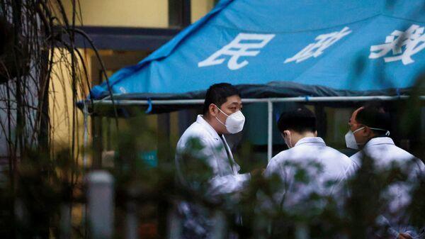 Expertos de la OMS en hospital de Wuhan - Sputnik Mundo