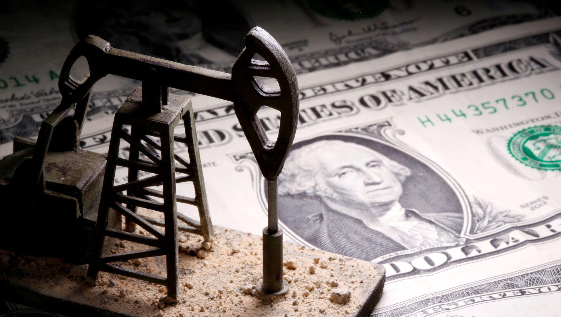 Una plataforma petrolera que fue impremida por una impresora 3D  y colocada sobre unos billetes de dólar  - Sputnik Mundo, 1920, 01.02.2021