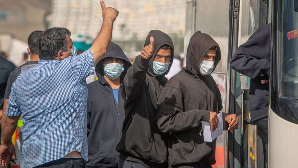 Imagen referencial de migrantes llegados a Canarias - Sputnik Mundo