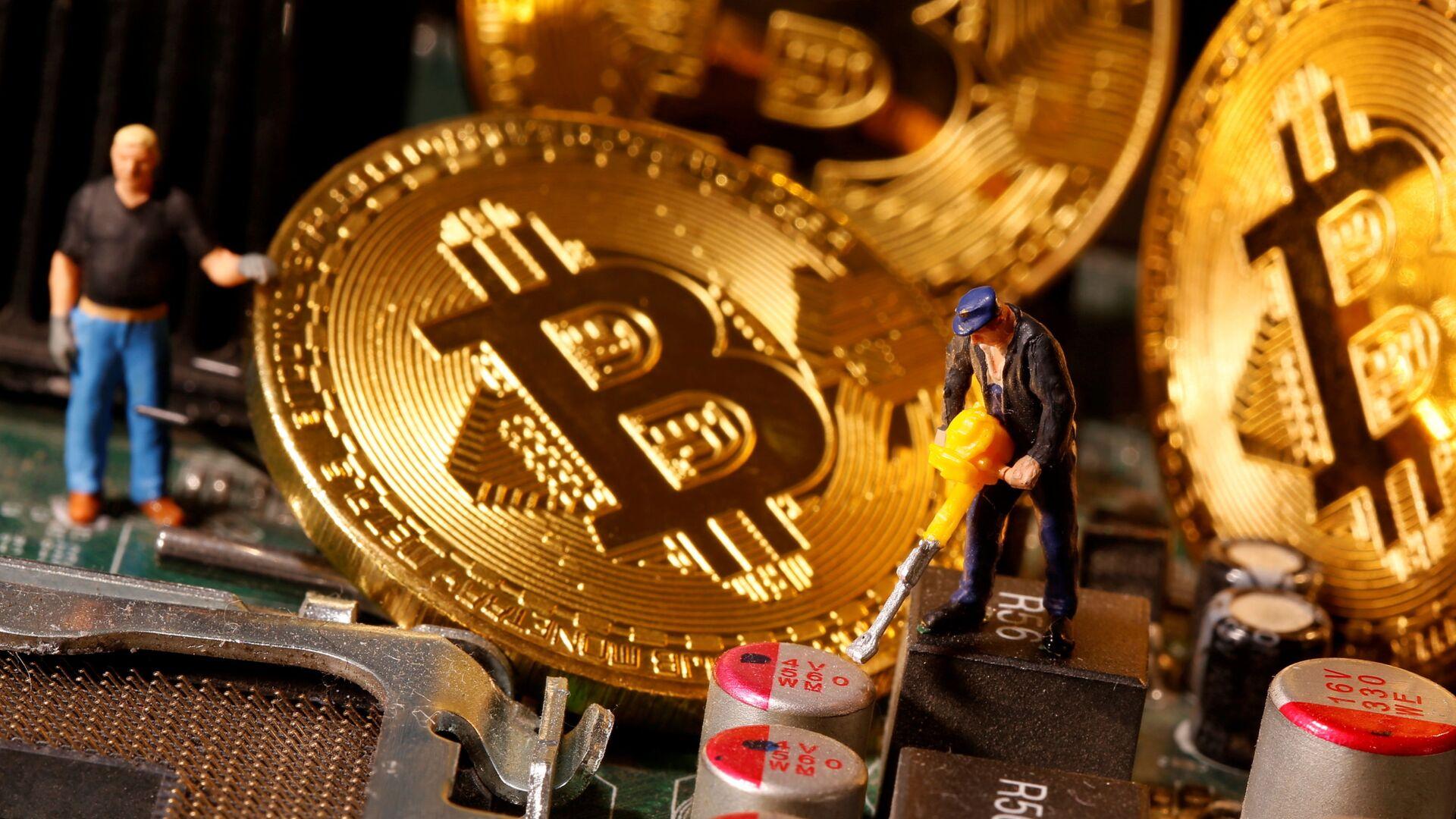 Una representación de bitcoines - Sputnik Mundo, 1920, 09.02.2021