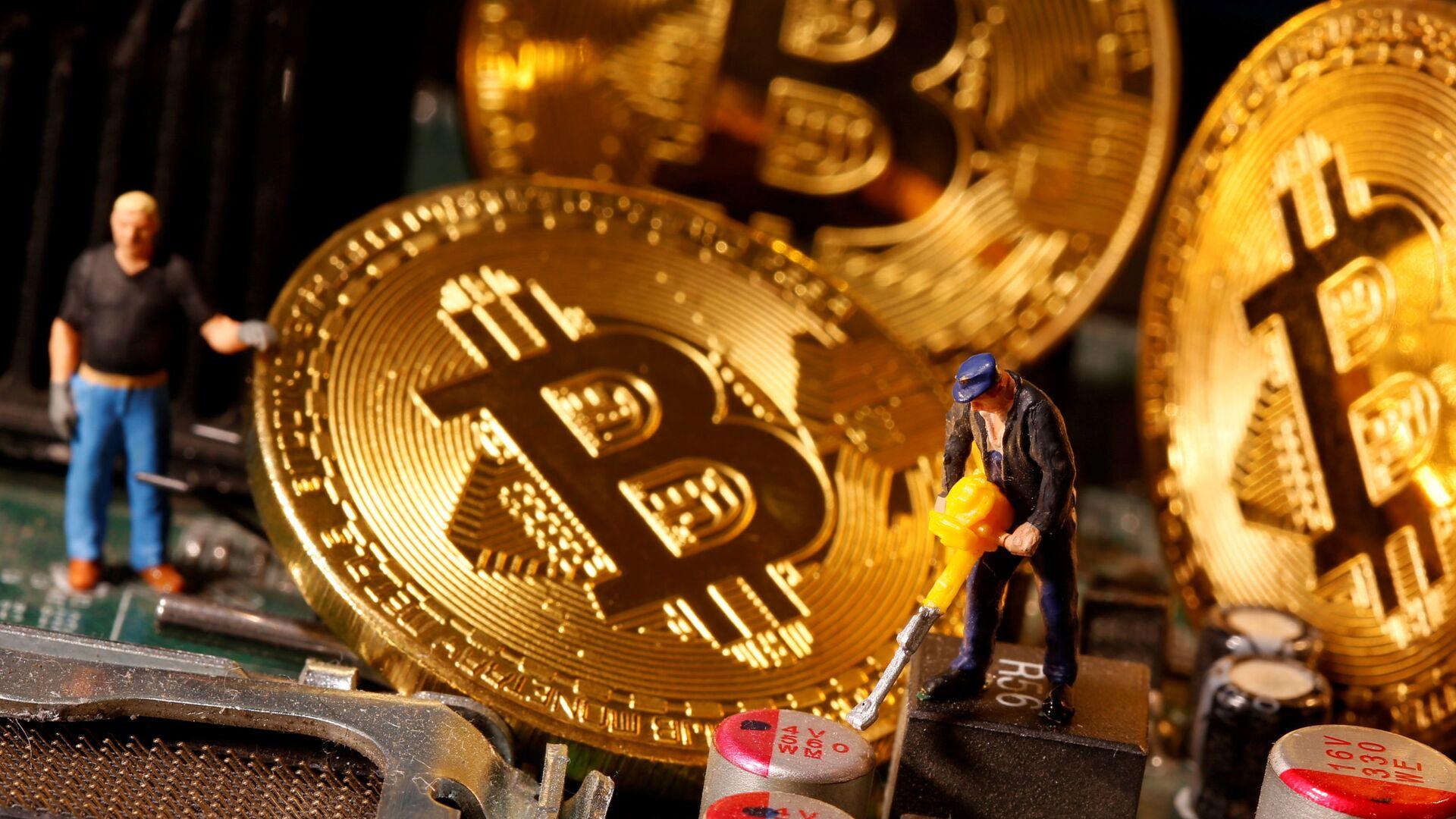 Una representación de bitcoines - Sputnik Mundo, 1920, 01.02.2021