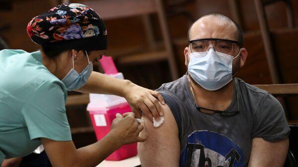 Vacunación contra el COVID-19 con Sputnik V en La Plata, Argentina - Sputnik Mundo