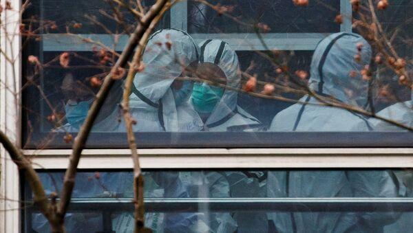 Los expertos de la OMS rastrean las huellas del origen del coronavirus - Sputnik Mundo
