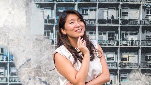 Quan Zhou Wu, autora de 'Gente de aqui, gente de allí' - Sputnik Mundo