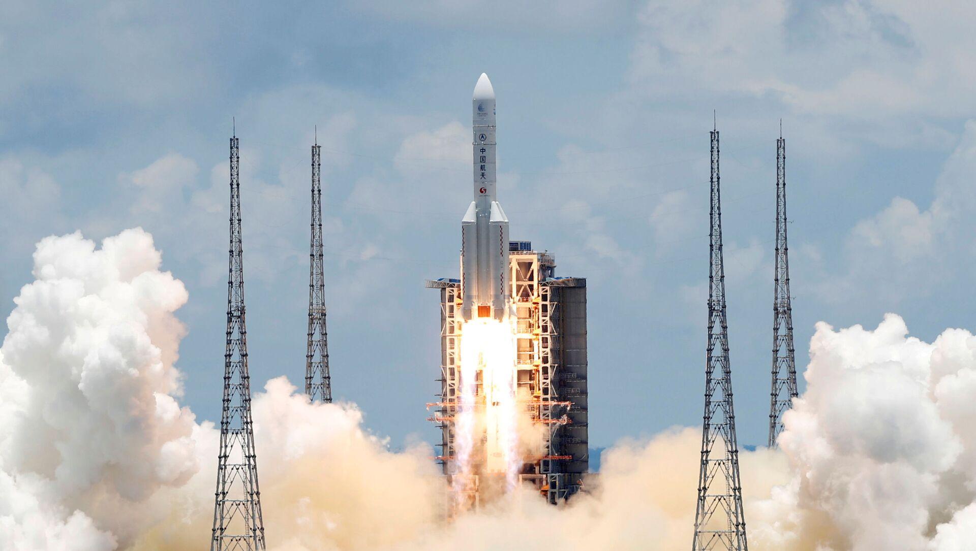 El cohete Long March 5 Y-4, que lleva la sonda china Tianwen-1 a Marte - Sputnik Mundo, 1920, 10.02.2021