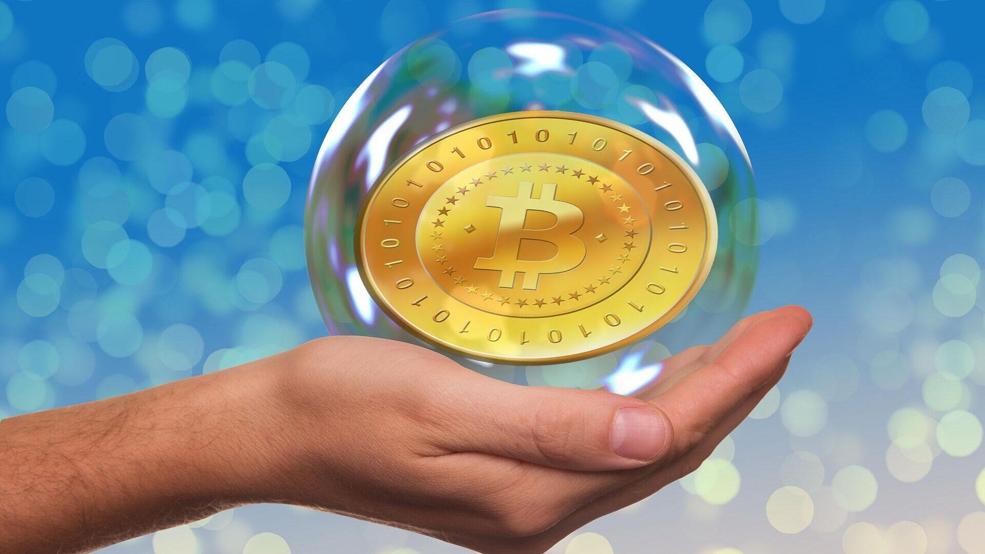 El bitcóin en una burbuta - Sputnik Mundo, 1920, 18.02.2021