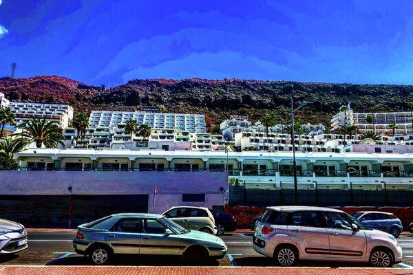 Hoteles de Puerto Rico, al sur de Gran Canarias, una de las zonas turísticas por excelencia y con más hoteles de acogida de inmigrantes - Sputnik Mundo