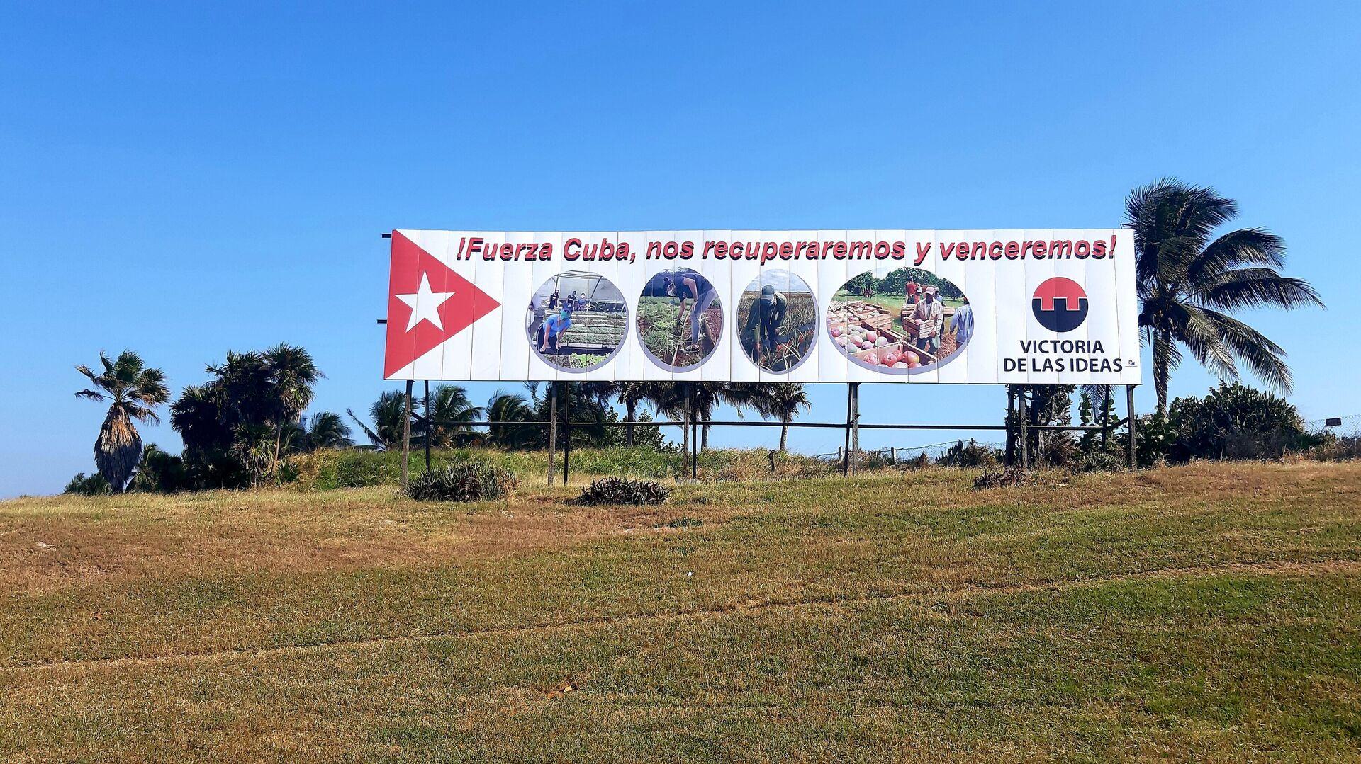 Carteles y consignas se colocan en varios puntos de las ciudades cubanas  - Sputnik Mundo, 1920, 01.03.2021