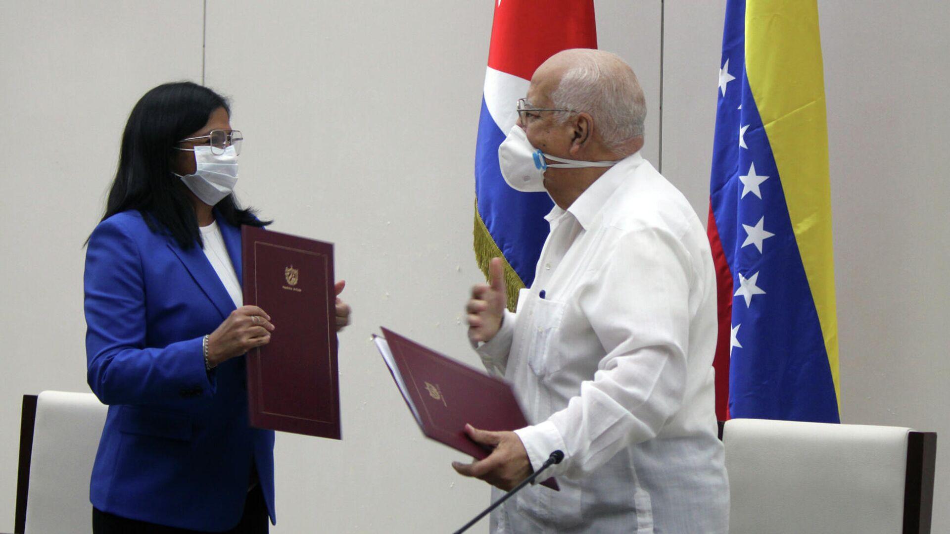 Vicepresidenta de Venezuela y viceprimer ministro de Cuba intercambian Convenio Integral de Cooperación Cuba-Venezuela - Sputnik Mundo, 1920, 09.03.2021