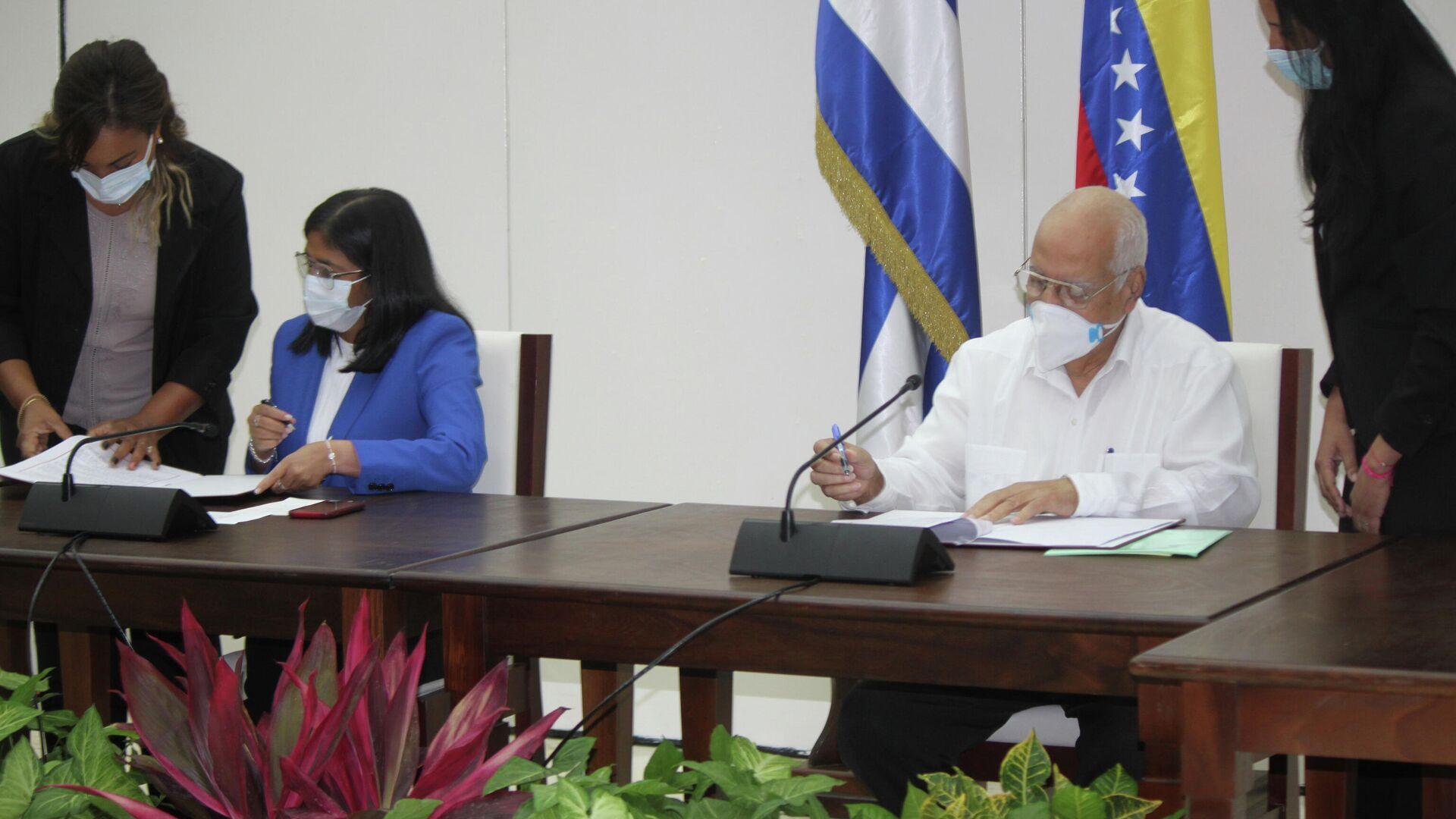 Delcy Rodriguez y Ricardo Cabrisas firman Convenio Integral de Cooperación Cuba-Venezuela - Sputnik Mundo, 1920, 10.03.2021