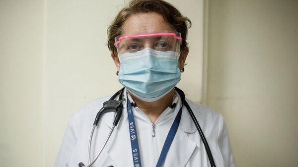 Carmen Zambrano, médica que durante un año ha estado a cargo del área COVID-19 del hospital Doctor Domingo Luciani - Sputnik Mundo