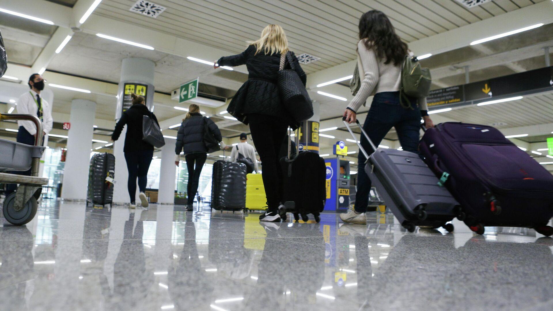 Turistas en el aeropuerto de Palma de Mallorca - Sputnik Mundo, 1920, 24.03.2021
