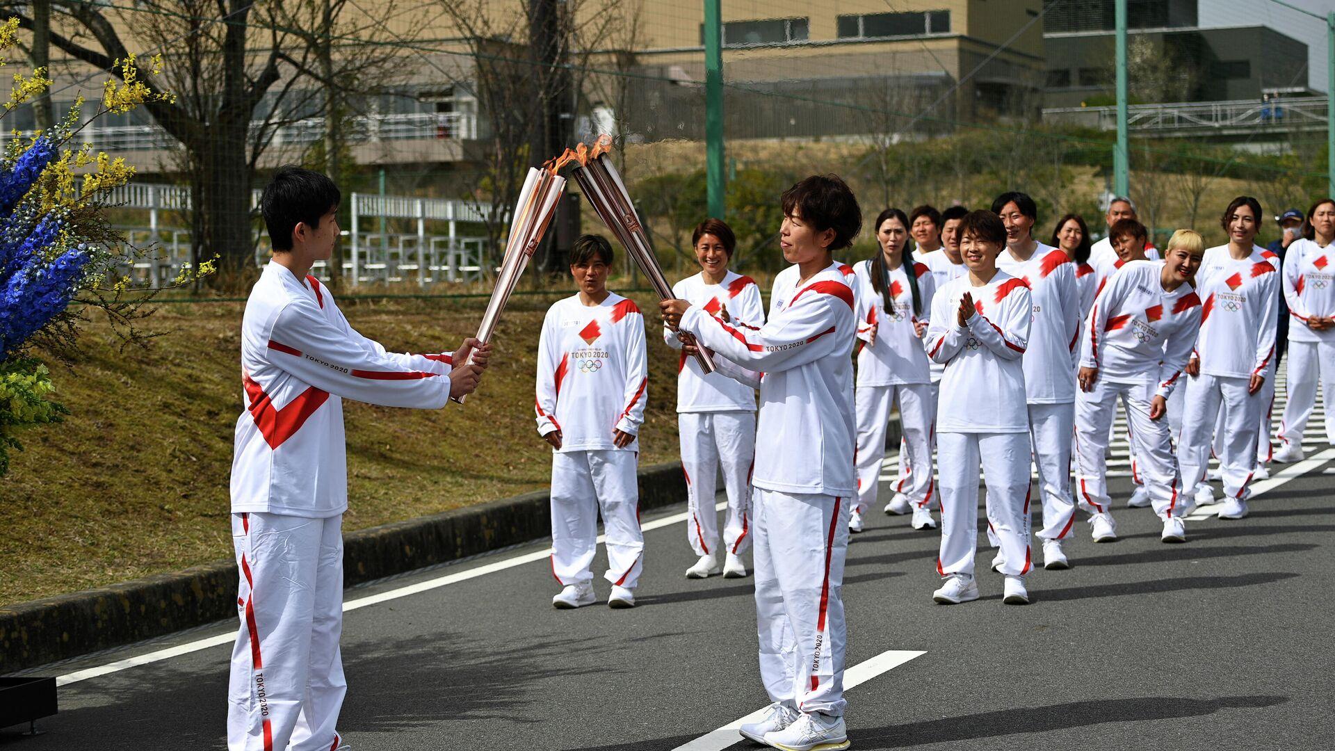 La ceremonia de relevo de la antorcha olímpica en Japón - Sputnik Mundo, 1920, 25.03.2021