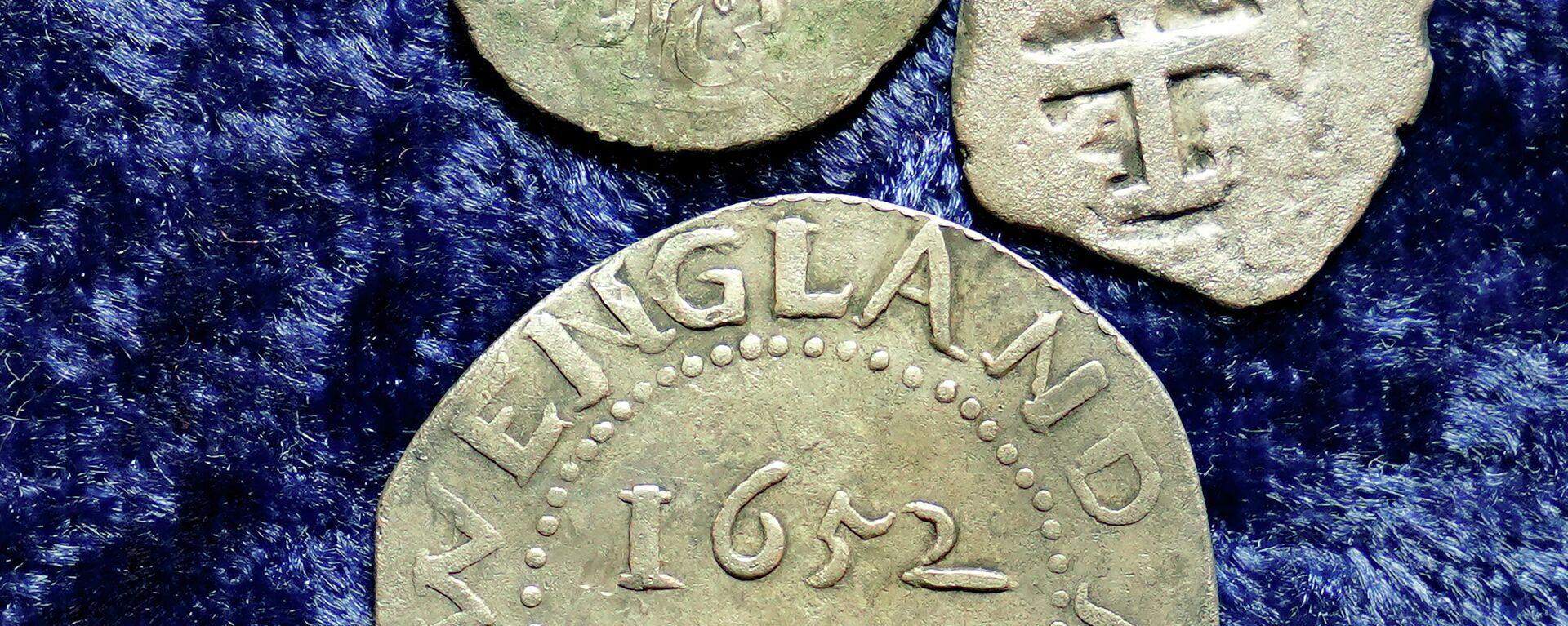 Monedas de plata árabes de la década del 1690 encontradas en una granja de la ciudad de Middletown, EEUU - Sputnik Mundo, 1920, 01.04.2021