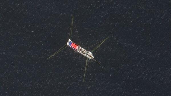 Вид на рыболовное судно у рифа Нюэцзяо в Южно-Китайском море  - Sputnik Mundo