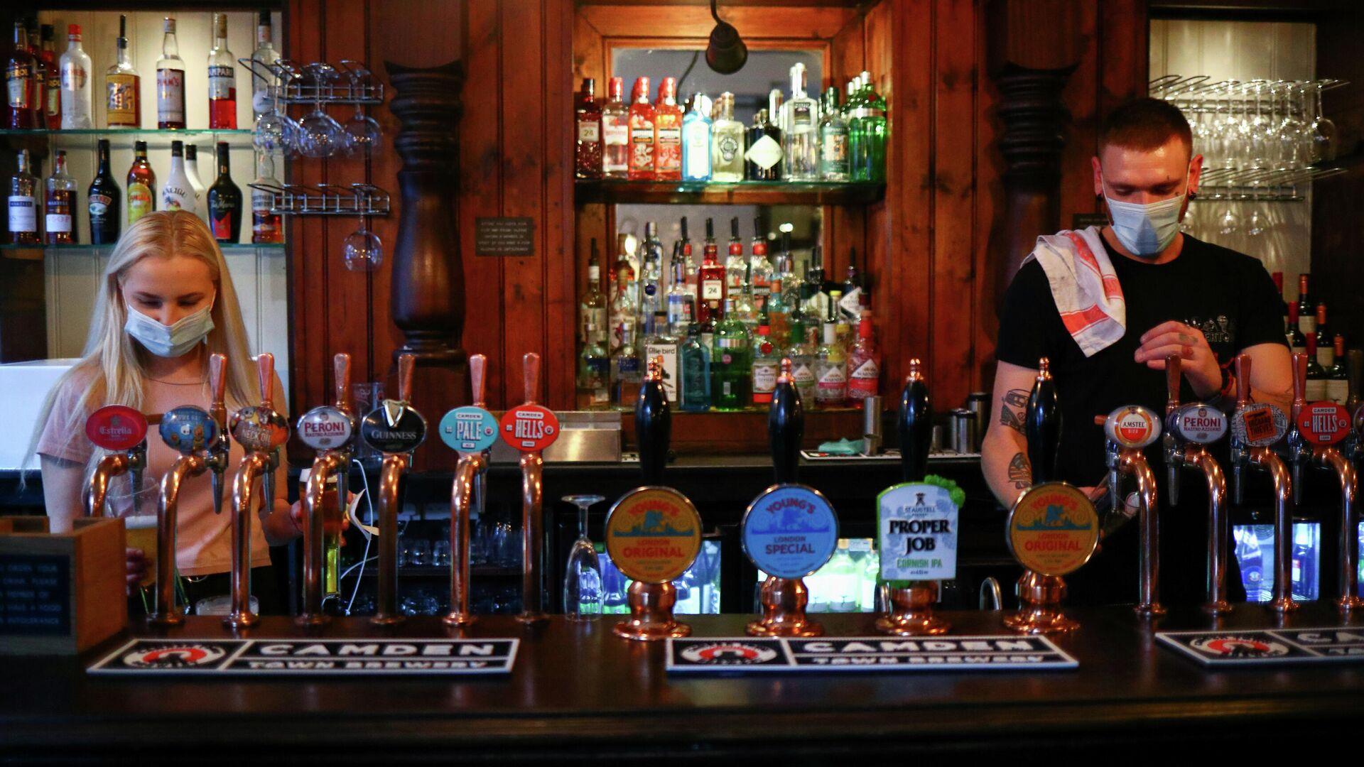 Un pub en Londres - Sputnik Mundo, 1920, 06.04.2021