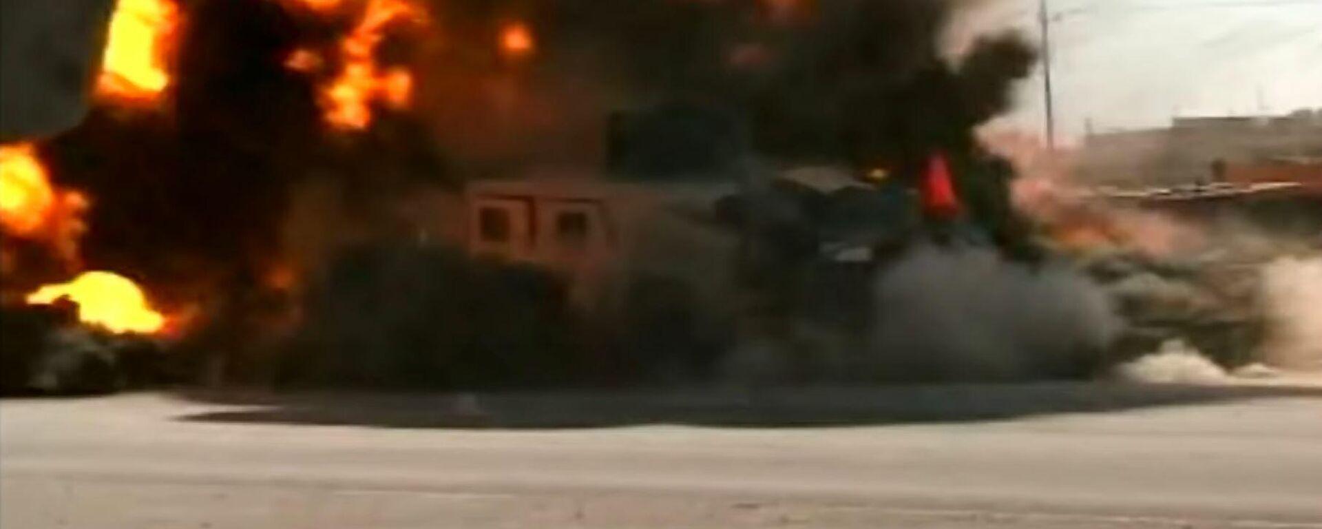 Un coche bomba vuela por los aires un Humvee estadounidense en Irak - Sputnik Mundo, 1920, 07.04.2021