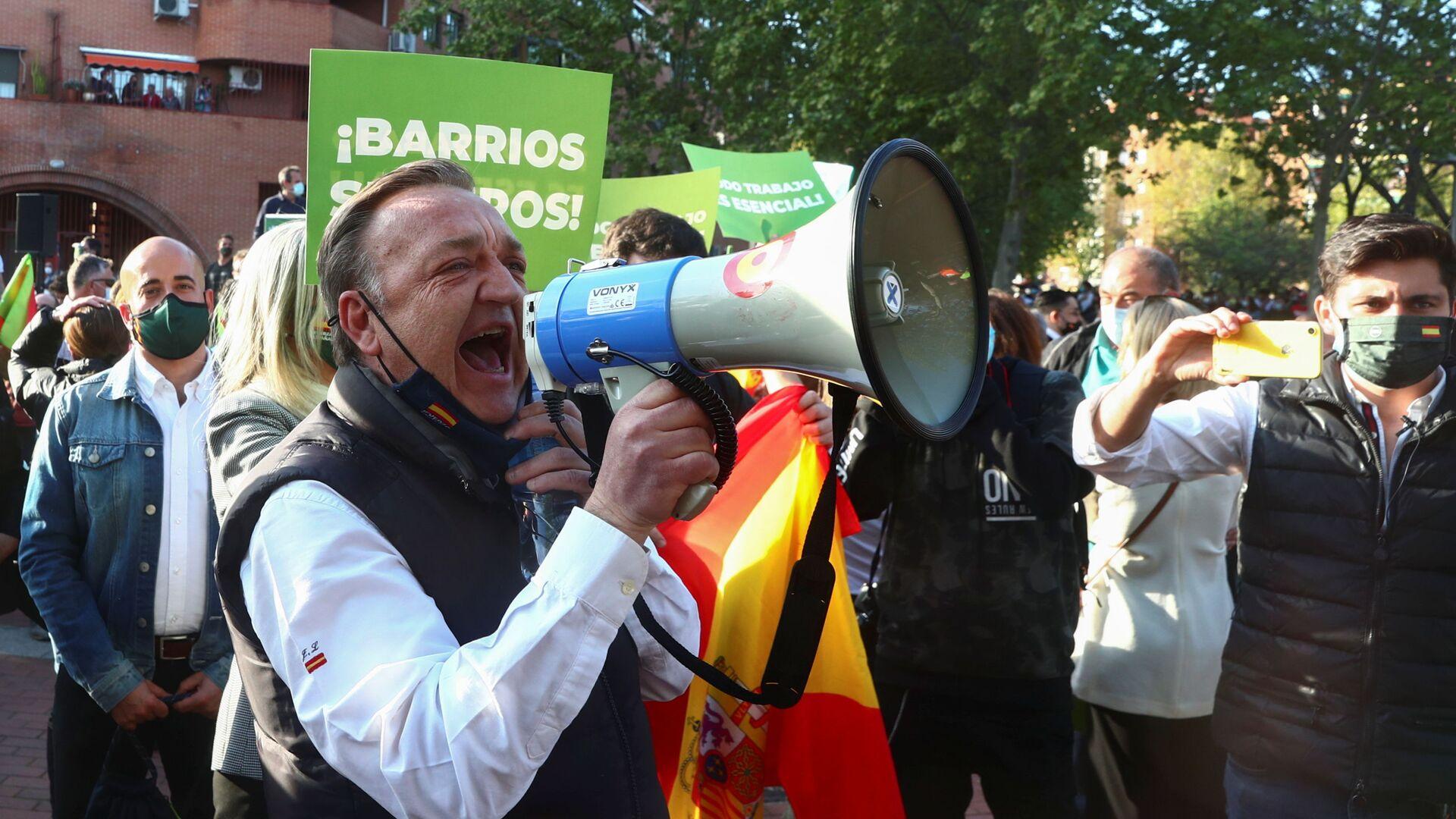 Una manfestación del partido Vox en Vallecas, Madrid - Sputnik Mundo, 1920, 08.04.2021