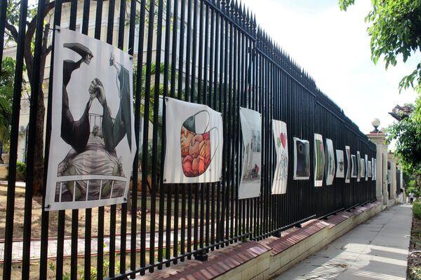 Сaricaturas en entrada del Ministerio de Cultura - XXII Bienal Internacional de Humorismo Gráfico  - Sputnik Mundo
