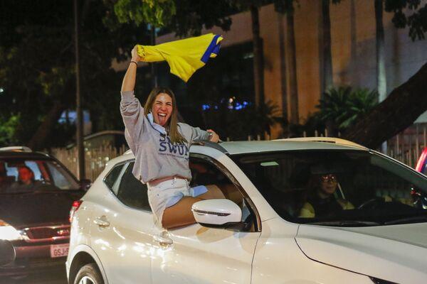 Simpatizantes de Guillermo Lasso (Ecuador) celebran en Guayaquil su victoria en las elecciones presidenciales. - Sputnik Mundo