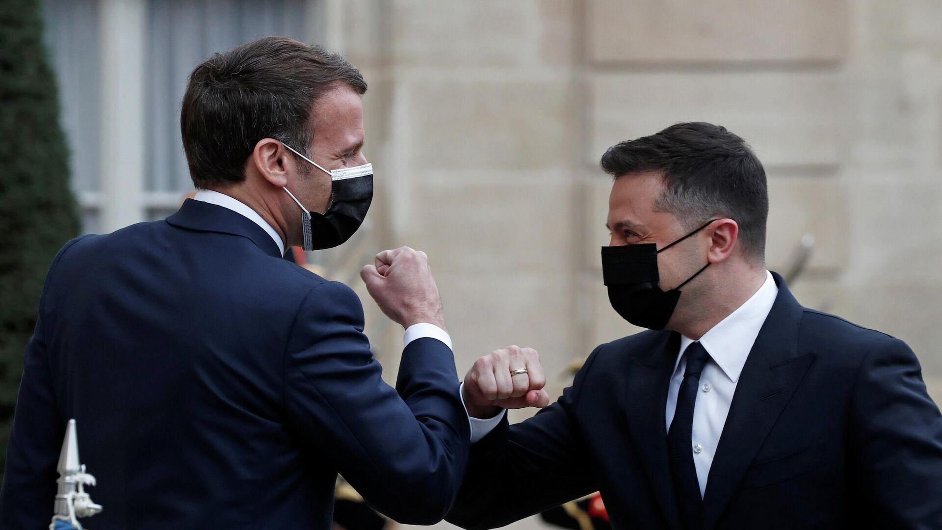 El encuentro del presidente de Francia, Emmanuel Macron, con su par de Ucrania, Volodímir Zelenski - Sputnik Mundo, 1920, 19.04.2021
