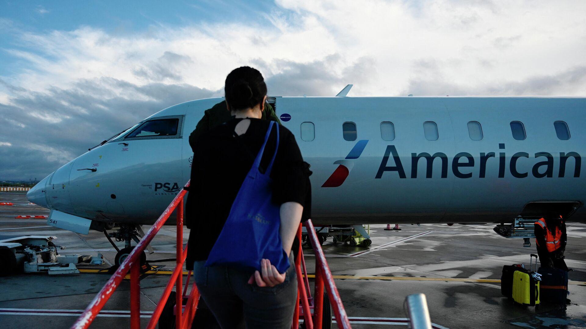 Pasajeros abordan un vuelo en el Aeropuerto Nacional Ronald Reagan de Washington. 11 de abril de 2021 - Sputnik Mundo, 1920, 21.04.2021