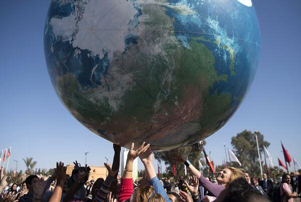 Los participantes en la 22 Conferencia Mundial de la ONU sobre el Cambio Climático en Marrakech, Marruecos. - Sputnik Mundo