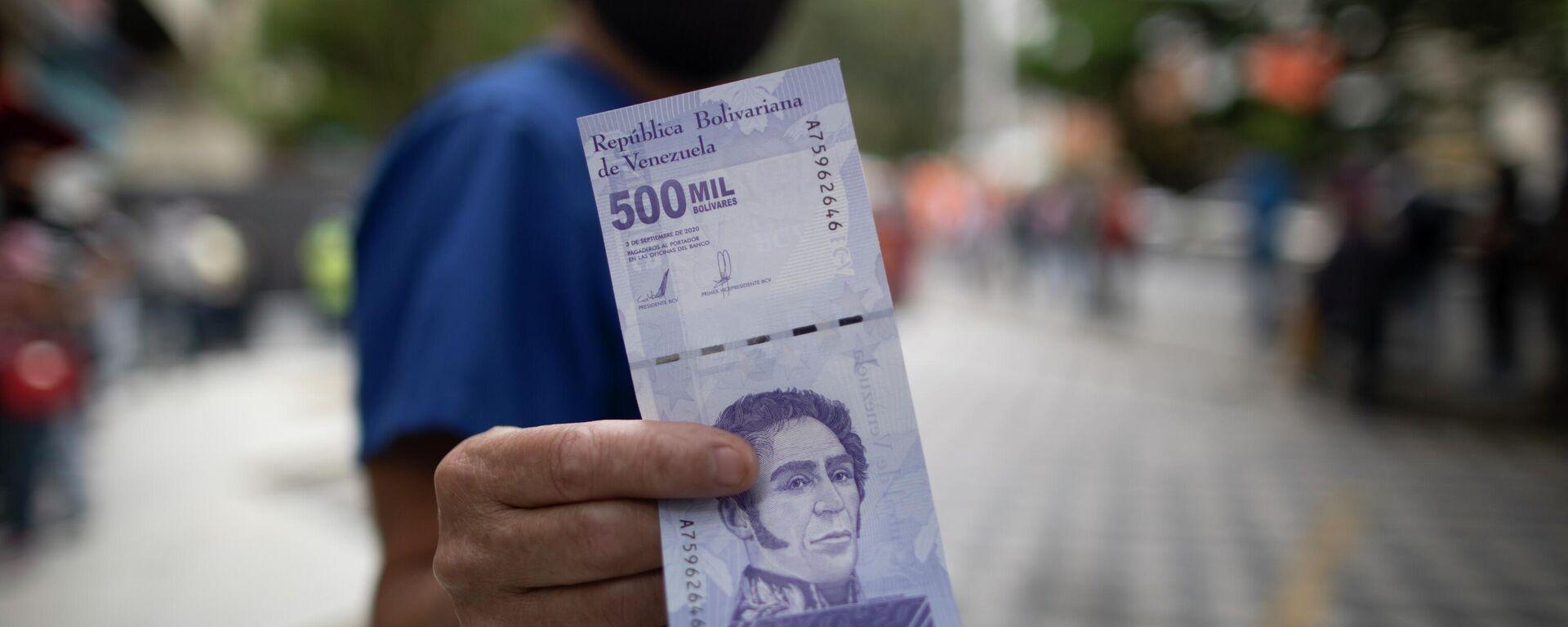 Un billete de 500 mil bolívares venezolanos - Sputnik Mundo, 1920, 25.04.2021