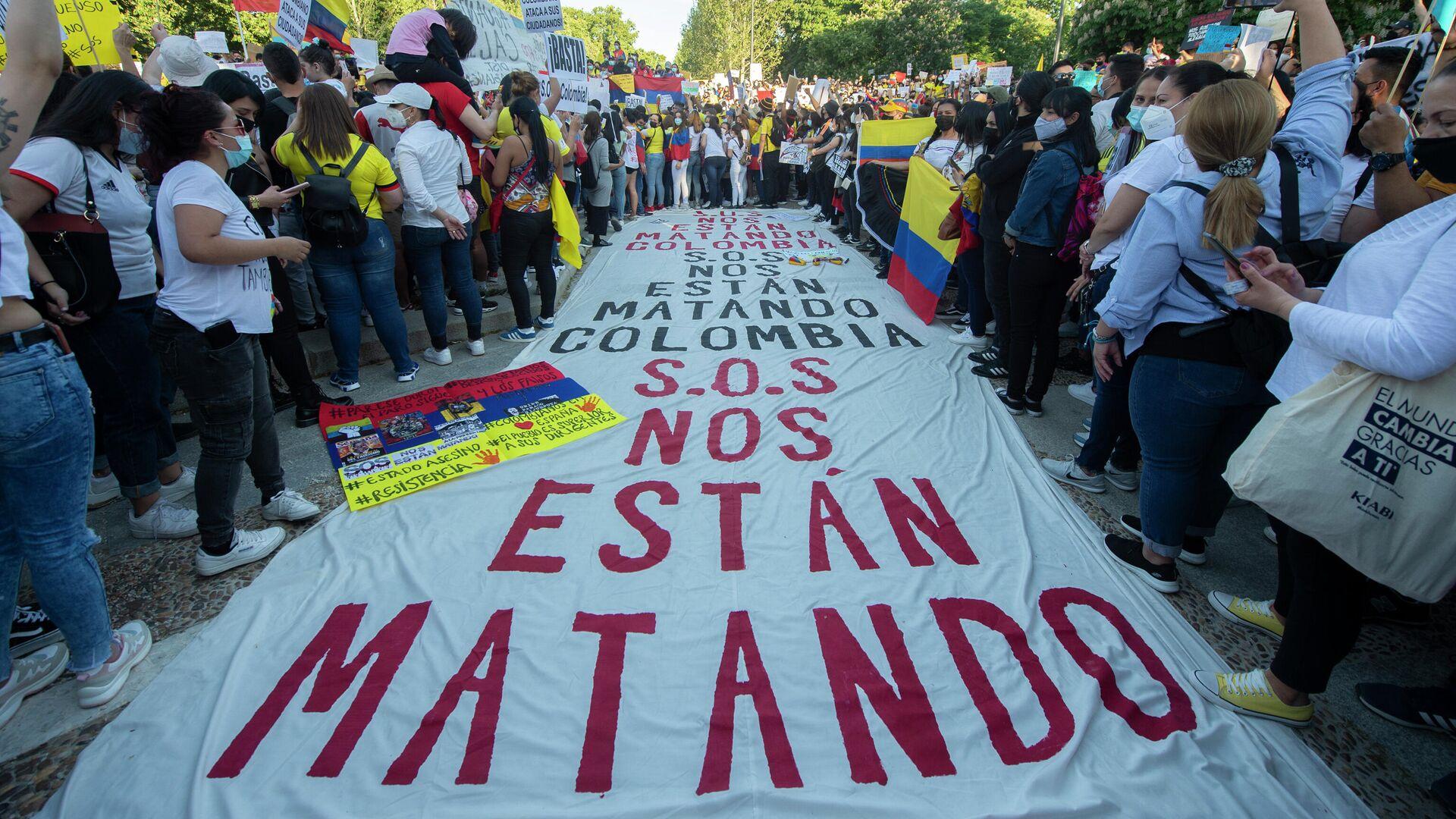 Manifestación en Madrid a favor de los manifestantes en Colombia - Sputnik Mundo, 1920, 07.05.2021