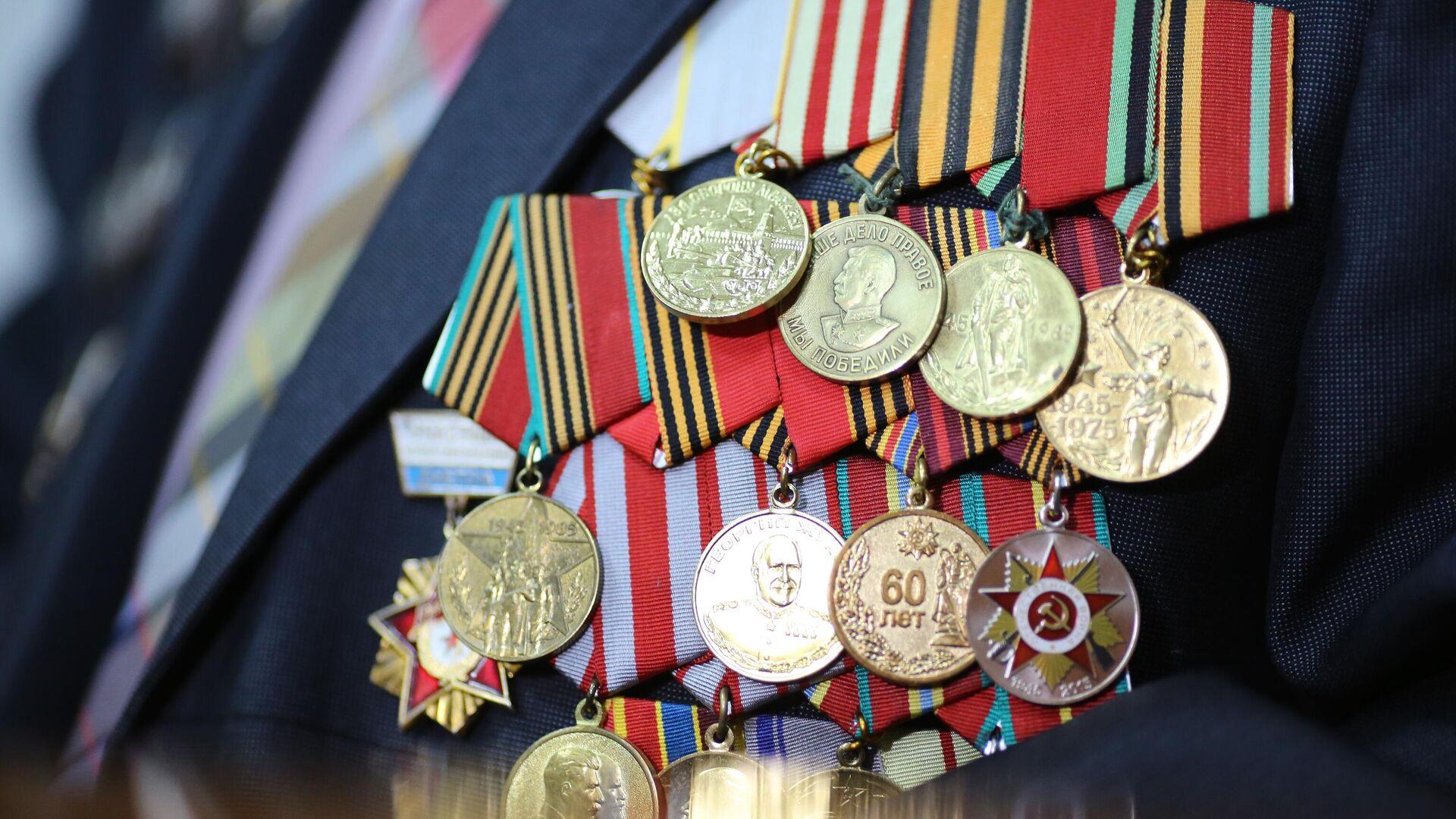 Unas medallas por defender la patria (imagen referencial) - Sputnik Mundo, 1920, 08.05.2021
