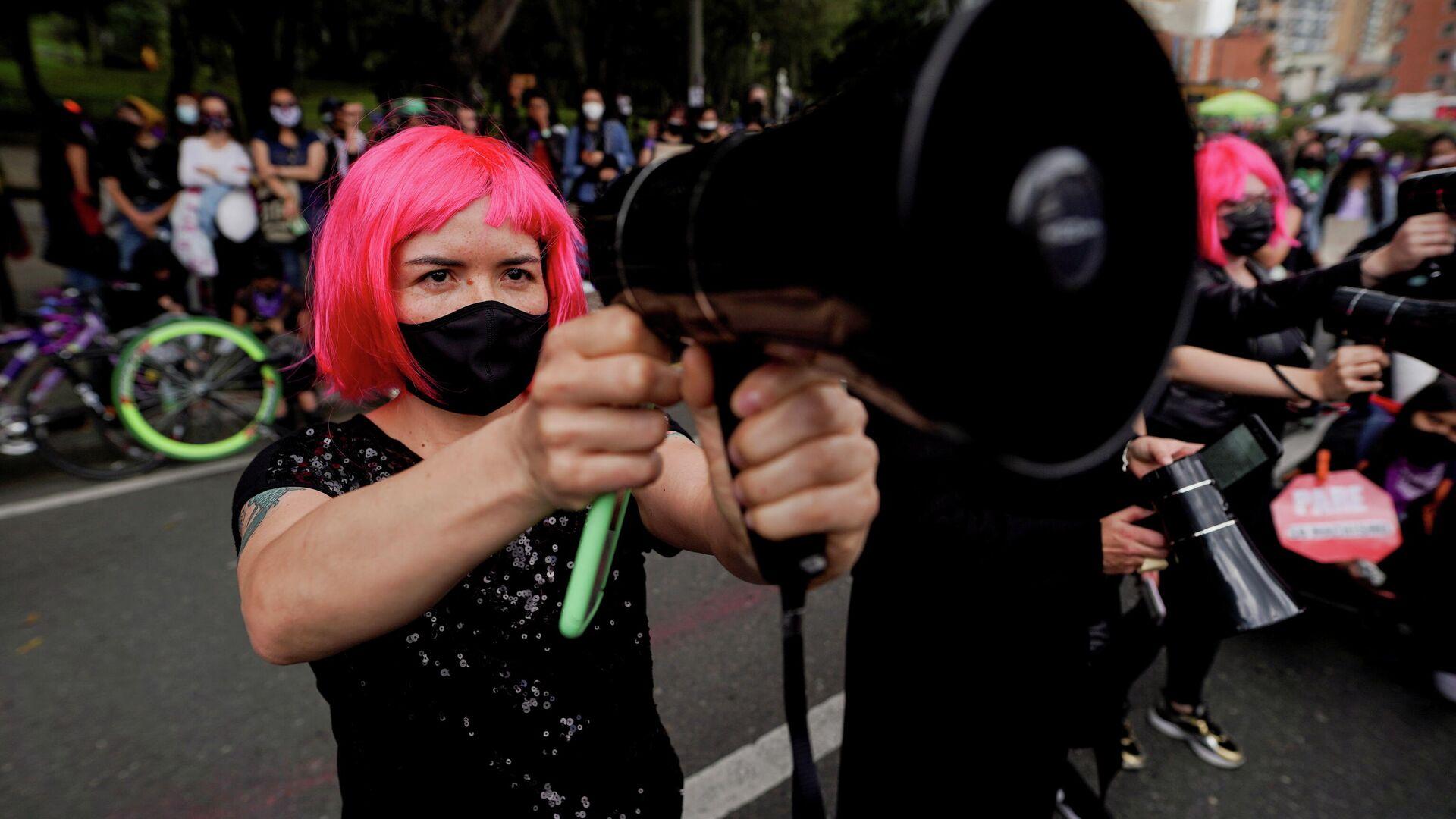 Mujeres protestando en Bogotá, Colombia - Sputnik Mundo, 1920, 15.05.2021