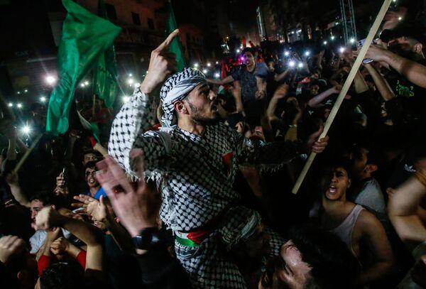 """Los vecinos de la Franja de Gaza celebran la """"victoria de la resistencia"""" en la batalla que Hamás bautizó como 'Espada de Jerusalén'. - Sputnik Mundo"""